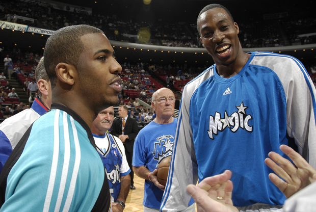 Chris Paul (New Orleans Hornets) y Dwight Howard (Orlando Magic)./ Getty Images