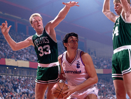 Larry Bird #33 of the Boston Celtics goes up to block a shot against the Real Madrid  during the 1988 McDonald's Open circa 1988 in Madrid, Spain