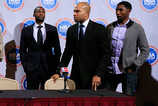 Keyon Dooling, Derek Fisher y Roger Mason./ Getty Images