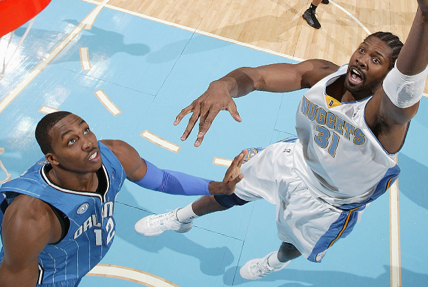 Dwight Howard y Nene./ Getty Images
