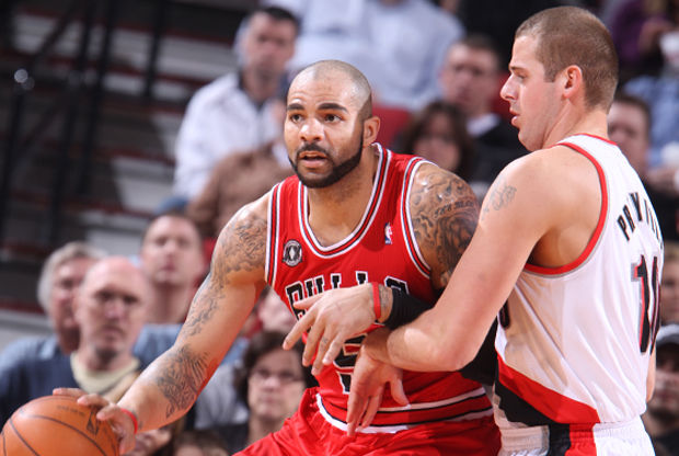 Carlos Boozer y Joel Przybilla./ Getty Images