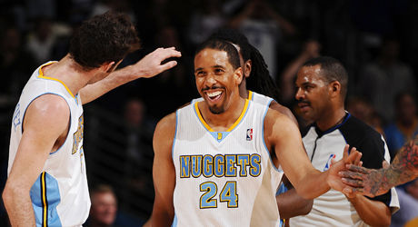 Andre Miller y Rudy Fernández./ Getty Images