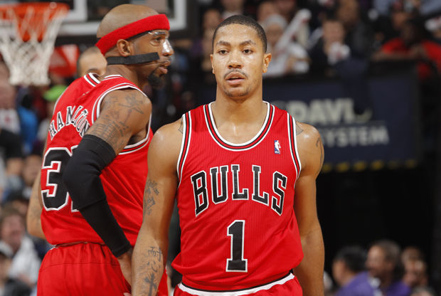 Derrick Rose y Richard Hamilton./ Getty Images