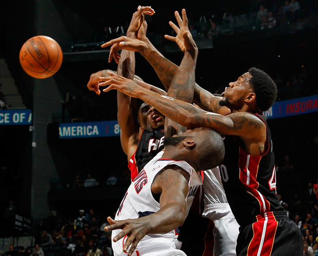 Terrel Harris, Udonis Haslem e Ivan Johnson./ Getty Images
