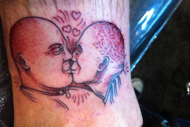 Tatuaje de Charles Barkley y Dick Bavetta