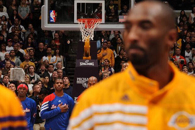 Kobe Bryant y Chris Paul./ Getty