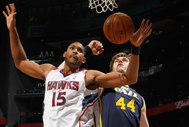Al Horford y Kyrylo Fesenko./ Getty Images