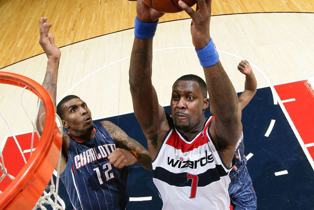 Andray Blatche y Tyrus Thomas./ Getty Images