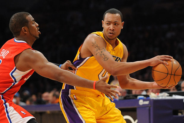 Andrew Goudelock y Chris Paul./ Getty Images