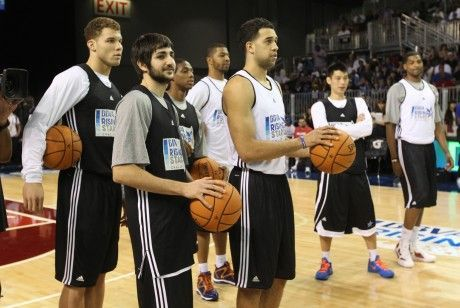 Blake Griffin, Ricky Rubio, Landry Fields./ Getty Images