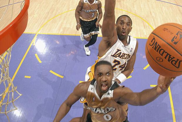 Gilbert Arenas y Kobe Bryant./ Getty Images