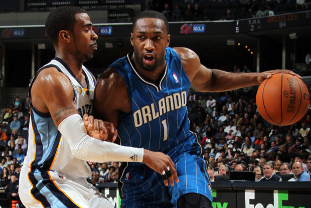 Gilbert Arenas y Mike Conley./ Getty Images