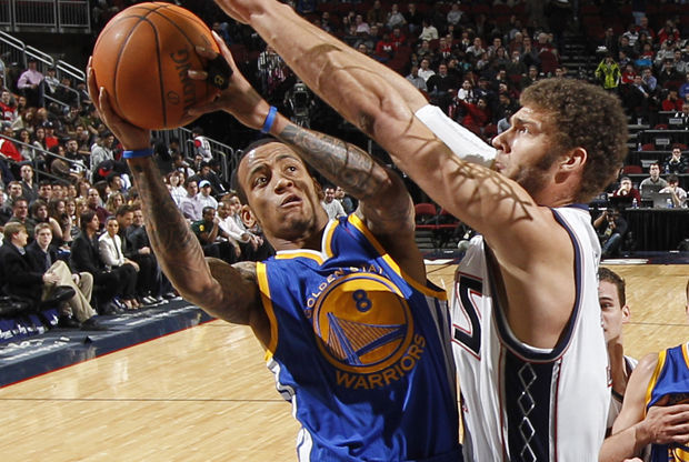 Monta Ellis y Brook Lopez./ Getty Images