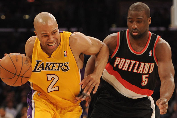 Derek Fisher y Raymond Felton./ Getty Images
