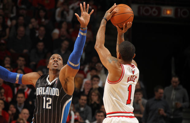 Dwight Howard y Derrick Rose./ Getty Images