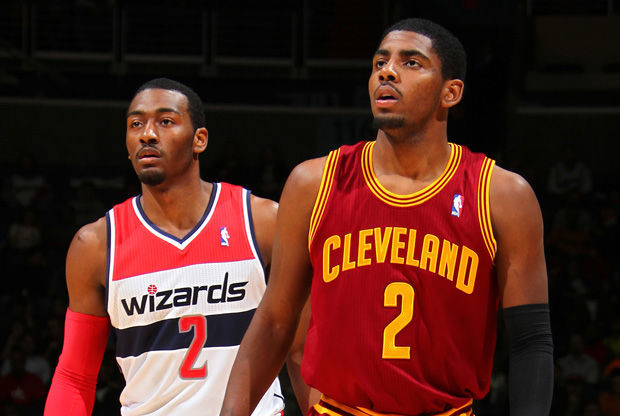 Kyrien Irving (Cleveland) y John Wall (Wizards)./ Getty