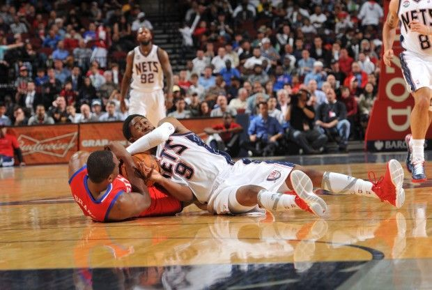 Marshon Brooks y Elton Brand./ Getty Images