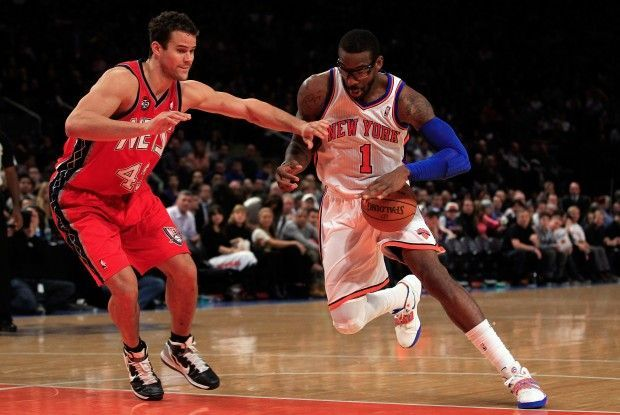 Kris Humphries y Amare Stoudemire./ Getty Images