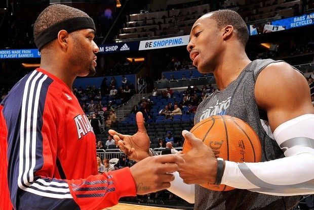 Josh Smith, Dwight Howard./ Getty Images