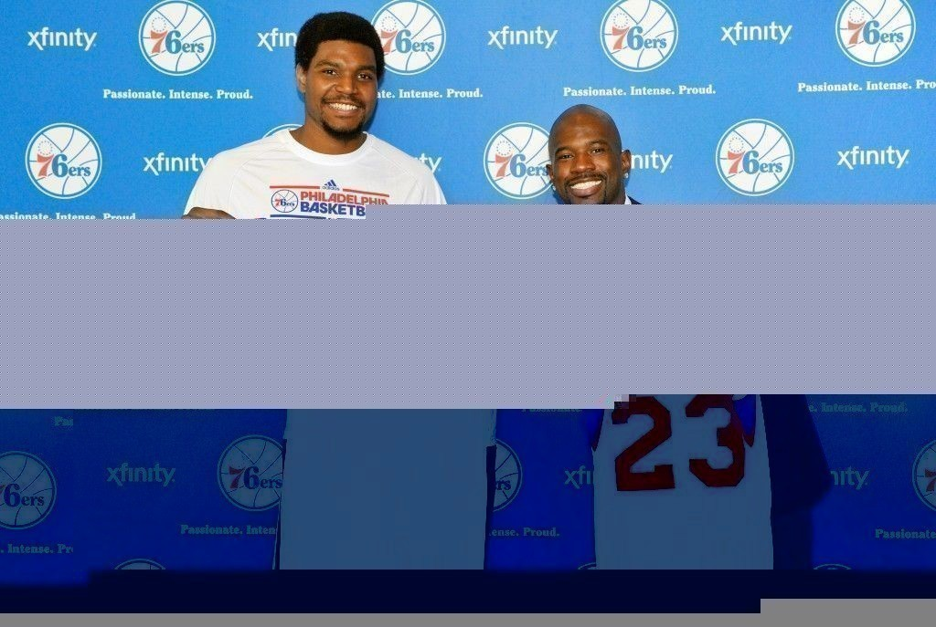 Andrew Bynum, Jason Richardson./ Getty Images