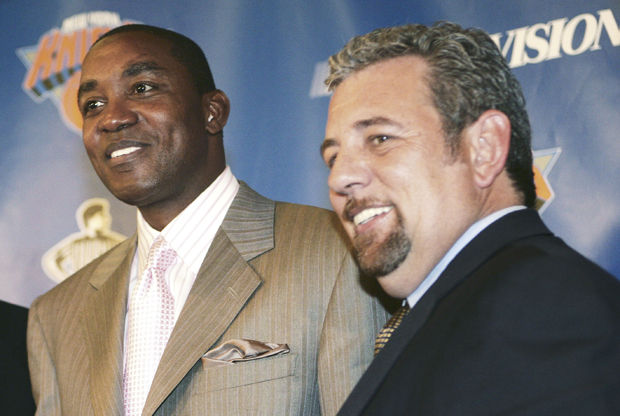 Isiah Thomas y James Dolan./ Getty Images