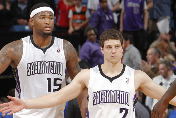 Jimmer Fredette y DeMarcus Cousins./ Getty Images