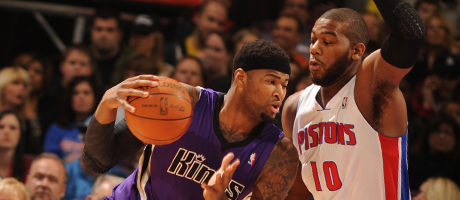 Greg Monroe y DeMarcus Cousins./ Getty Images