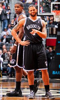 Deron Williams y Joe Johnson./ Getty Images