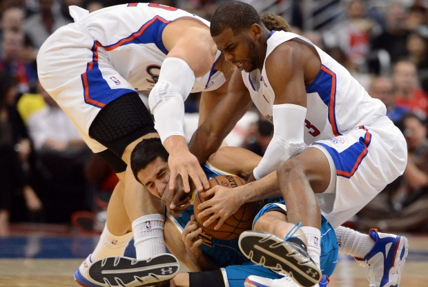Blake Griffin, Chris Paul y Greivis Vasquez./ Getty Images