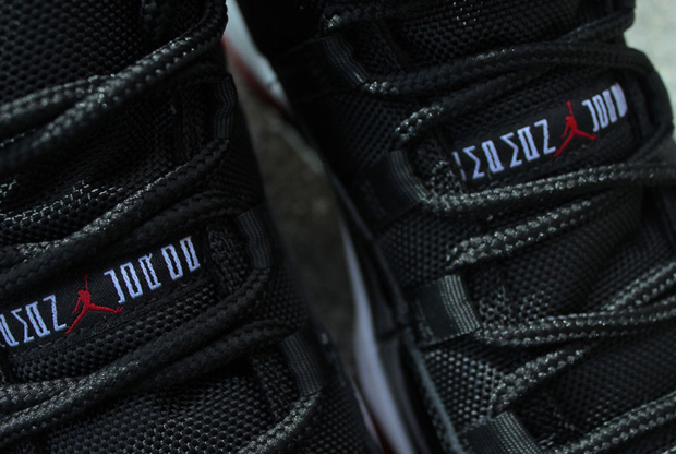 Air Jordan – 11 Retro 'Black/White & Varsity Red'