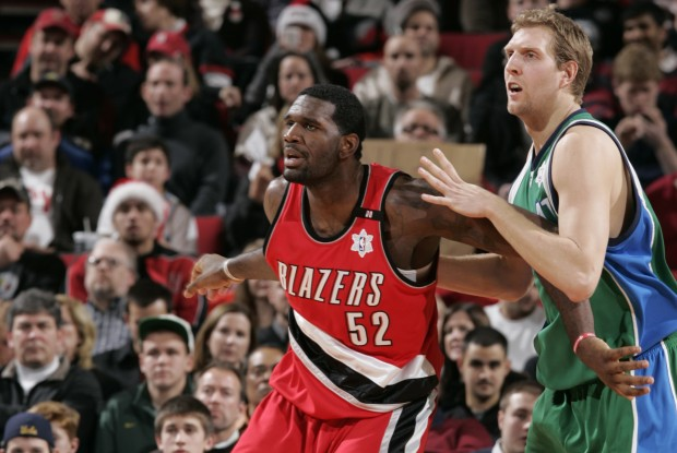Greg Oden y Dirk Nowitzki./ Getty Images