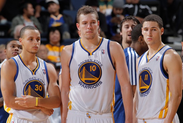 Stephen Curry, David Lee y Klay Thompson./ Getty Images