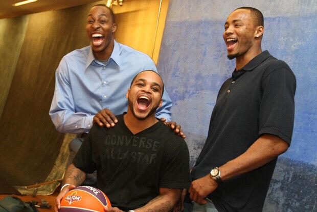 Dwight Howard, Jameer Nelson y Rashard Lewis./ Getty Images