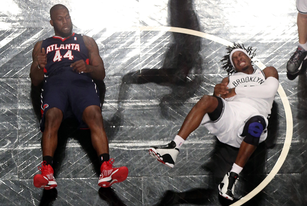 Ivan Johnson y Gerald Wallace./ Getty Images