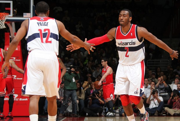 A.J. Price y John Wall./ Getty Images