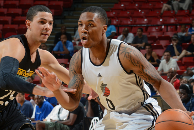 Damian Lillard y Austin Rivers./ Getty Images