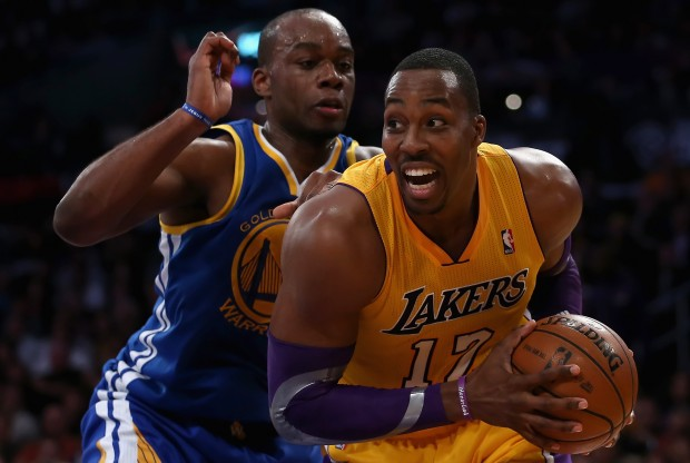 Dwight Howard y Carl Landry./ Getty Images
