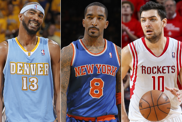Corey Brewer, J.R. Smith y Carlos Delfino./ Getty Images