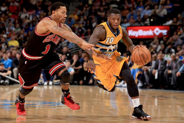 Derrick Rose y Nate Robinson./ Getty Images