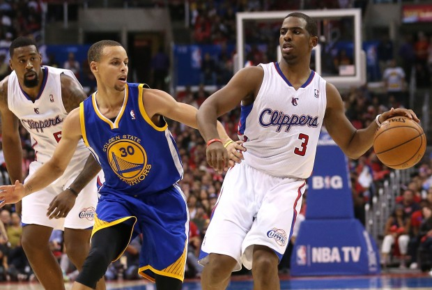 Stephen Curry y Chris Paul./ Getty Images