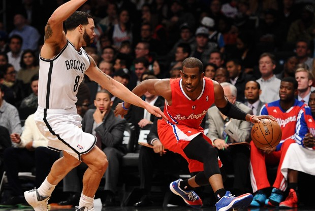 Chris Paul se marcha por velocidad de Deron Williams./ Getty Images