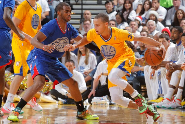Chris Paul y Stephen Curry./ Getty Images
