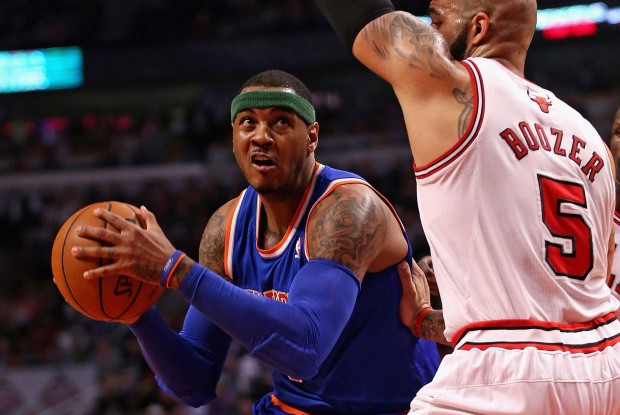 Carmelo Anthony y Carlos Boozer./ Getty Images