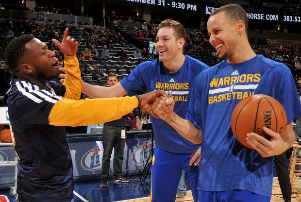 Nate Robinson, David Lee y Stephen Curry./ Getty Images