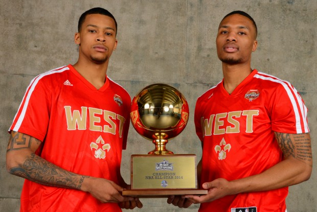 Trey Burke y Damian Lillard./ Getty Images