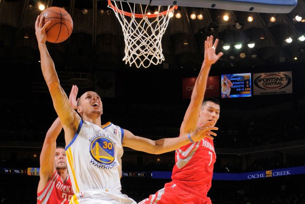 Stephen Curry y Jeremy Lin./ Getty Images