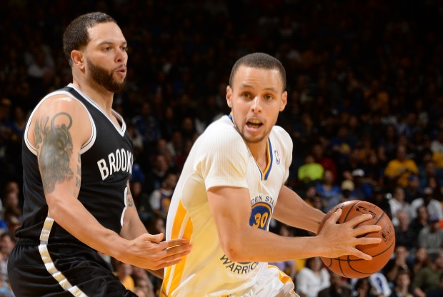 Deron Williams y Stephen Curry./ Getty Images