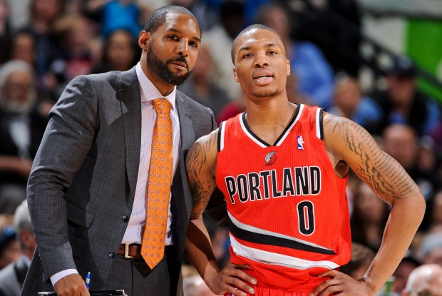 Victor Vanterpool y Damian Lillard./ Getty Images