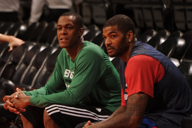 Rajon Rondo y Josh Smith./ Getty Images