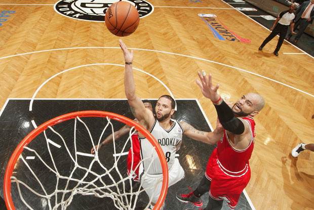 Deron Williams y Carlos Boozer / Getty Images